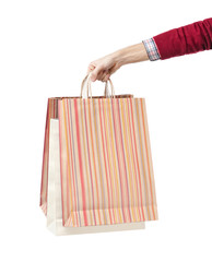 Hand holds some paper bags, isolated on white