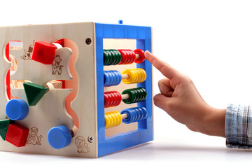 Fototapeta A child playing with abacus