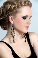 Beautiful woman with evening make-up. Evening hairdress