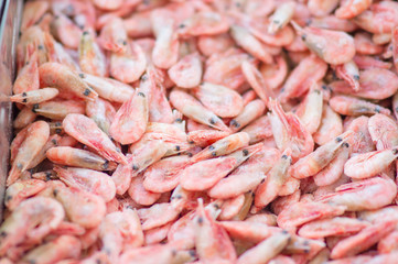 Bunch of fresh shrimps in fridge in supermarket