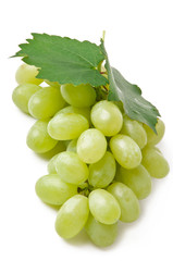 fresh grape fruits with green leaves isolated on white backgroun
