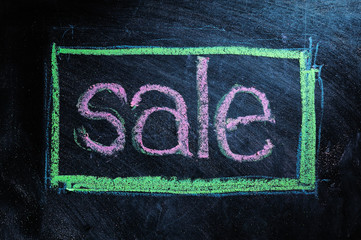 Sale handwritten with white chalk on a blackboard
