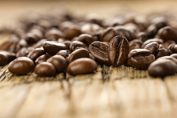 Coffee beans on the wooden vintage table