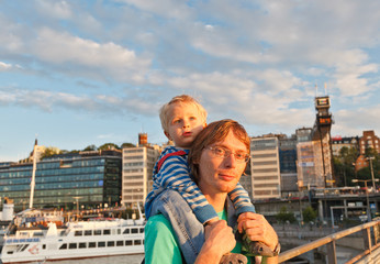 father and baby at the pier in Stockholm