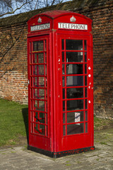 Red telephone booth in Hampton Court