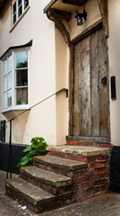 Rustic medieval timber door and foot step