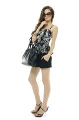 Urban beautiful young woman with modern a black handbag