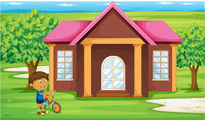 a boy infront of house