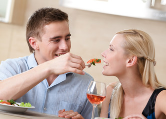 Couple has romantic supper in the kitchen