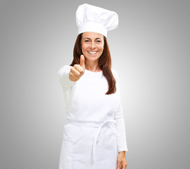 Chef woman showing thumbs up