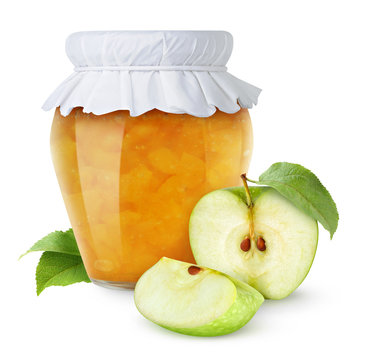 Isolated fruit jam. Glass jar of apple jam and cut green apples isolated on white background