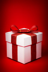 gift box with red ribbon on a red background