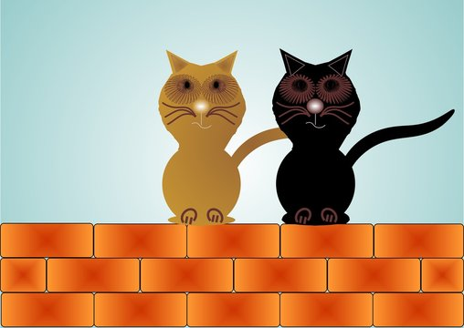 Two cats sitting on a wall