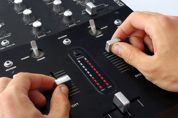 dj hands on mixer