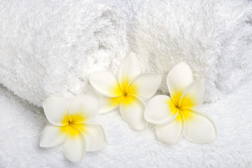 White towels  with white flowers for wellness