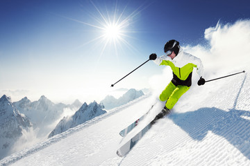 Poster Winter sports Skier in mountains, prepared piste and sunny day
