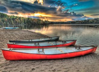 Fotomurales - Three Canoes Alongside A Lake