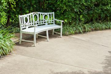 White bench in the garden