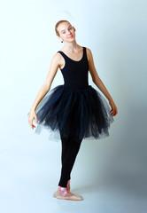 teen girl ballerina dancer in black tutu