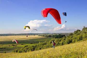 Foto op Aluminium Luchtsport Multiple paragliders soar in the air amid wondrous landscape