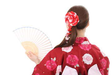 Back view of young asian woman in clothes of kimono