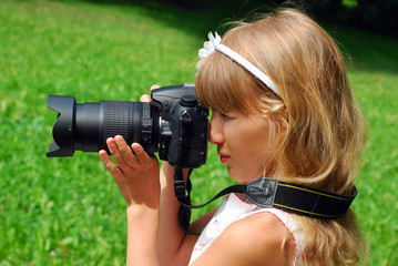 young girl with digital camera