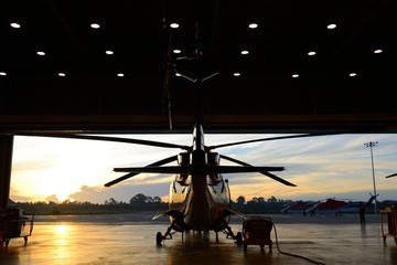 Printed roller blinds Helicopter silhouette of helicopter in the hangar