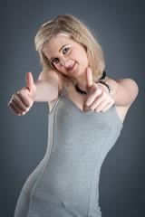 Portrait of blonde teenager girl on dark background.