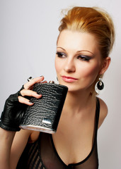 Young lady in rock style with the flask