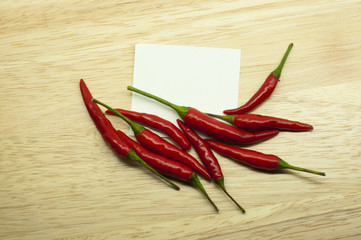 thai red hot chili with white paper on wood background