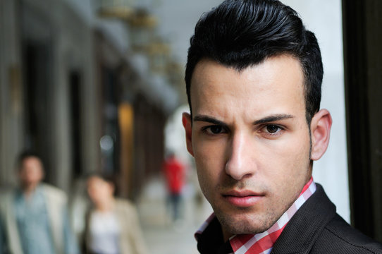 Handsome man wearing jacket and shirt in urban background