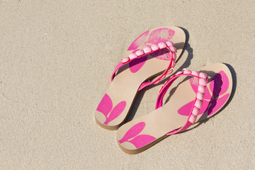 Slippers in the sand sea