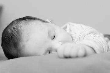 Black and white picture of a baby sleeping