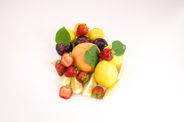 Fresh orange, lemons, strawberries and plums