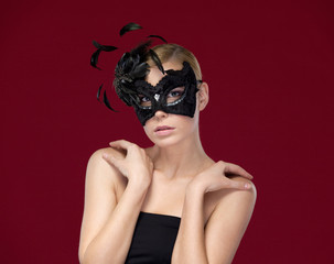 Attractive woman with black masquerade mask