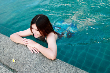 Woman at the Edge of a Swimming Pool