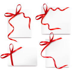 Collection of cards with red gift bows with ribbons