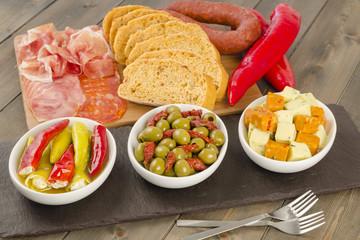 Tapas - Chilies, olives, cheese, lomo, chorizo & serrano ham