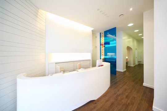 Lit reception area in dental clinic.