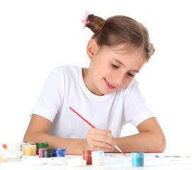 Cute little girl painting a picture, isolated on white