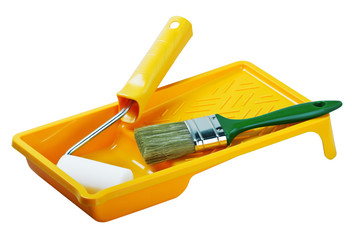 Yellow paint tray with foam roller and paintbrush