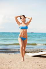 Spoed Foto op Canvas womenART happy woman with wind surf on the beach
