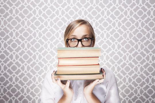 Woman Peering Over Books