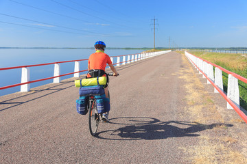 Wall Murals Cycling Cyclist on a causeway, road between Saaremaa and Muhu.
