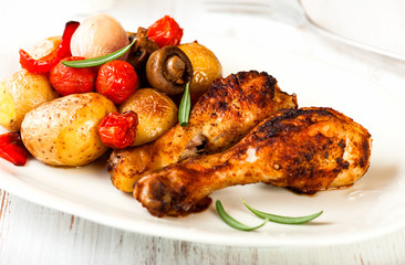 Roasted chicken with oven baked vegetables and mushrooms