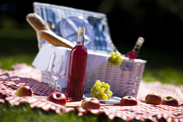 Wall Murals Picnic Wine and picnic basket on the grass