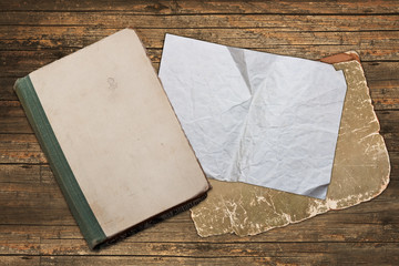 Weathered book and wrinkled paper