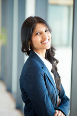 cheerful young asian businesswoman in office