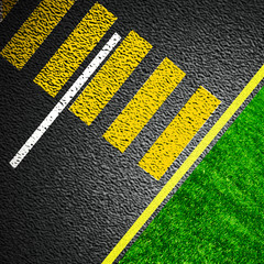 Asphalt as abstract background with grass
