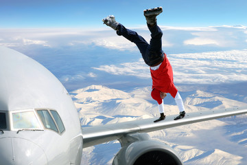 Extreme sport on on the plane wing